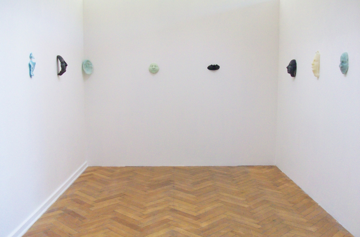 installation with waxfaces